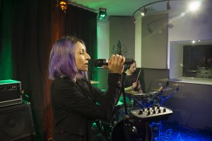Vocalist for Android Lust rehearses with a Hear Back OCTO mixer to create a custom monitor mix. Photo courtesy of Android Lust.