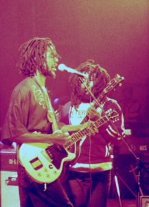 Peter Tosh (with Robbie Shakespeare in background), 1978. Courtesy of Wikimedia Commons/TimDuncan.