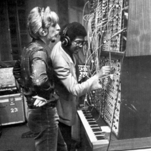 Patrick Gleeson and Herbie Hancock working with an E-mu Systems modular synthesizer.