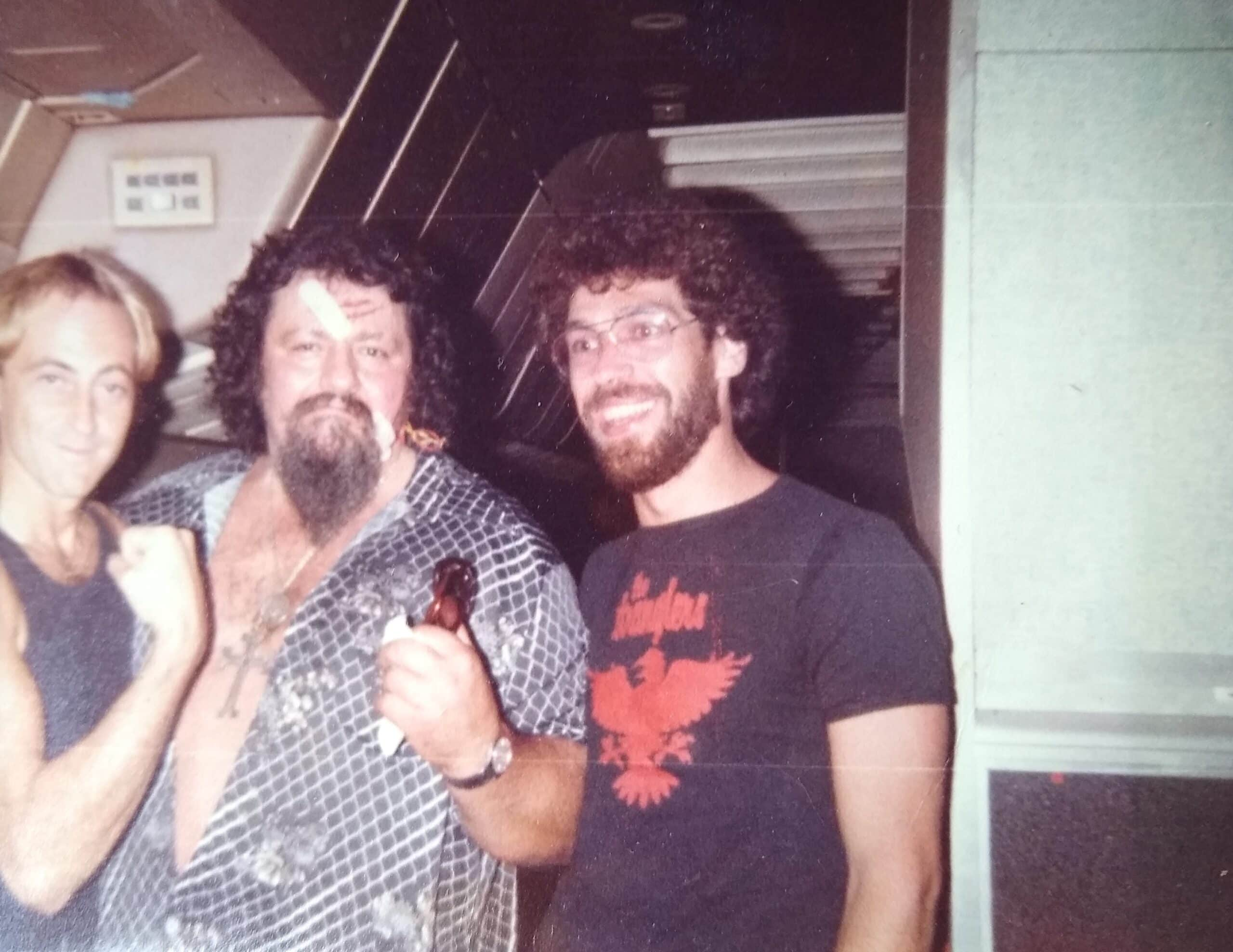 """A bandaged """"Capt."""" Lou Albano (middle) and Ken Sander (right) on that fateful plane ride in 1984."""