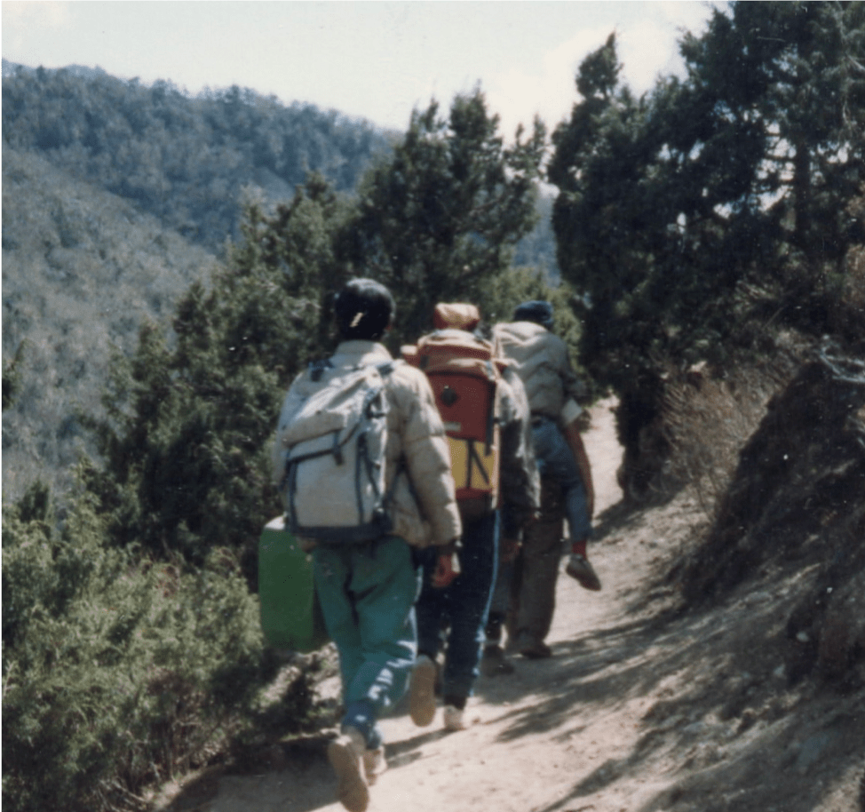 Wang Chuk in the lead position carrying the semi-conscious Dorje on his back, on their way to the rescue station. Photo by Alón Sagee.