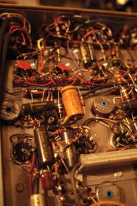 The insides of the Scott Type 299: No printed circuit boards, but point-to-point wiring instead! Photo courtesy of Agnew Analog Reference Instruments.