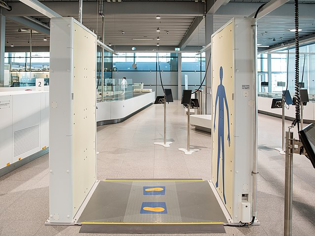 Airport full-body millimeter wave scanner. Courtesy of Wikimedia Commons/Raimond Spekking.