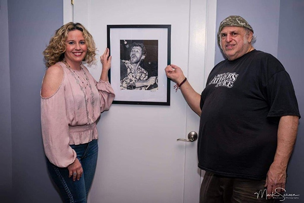 Amy Helm and Eppy with picture of Levon Helm. Photo courtesy of Mark Schoen.