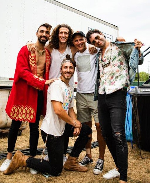 Cliff Chenfeld (with hat) with members of The Revivalists and Magic Giant.