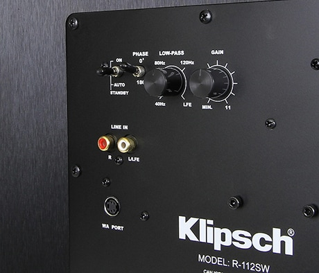 Klipsch R-112SW subwoofer rear panel showing phase switch and other controls.