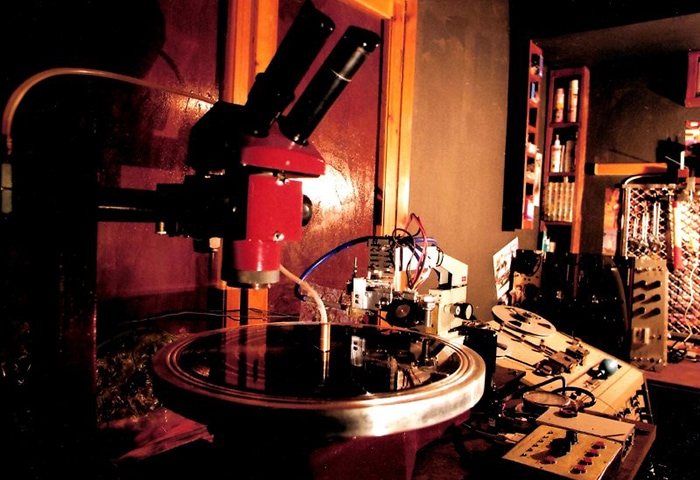 One of the author's custom disk mastering lathes, with an MCI JH-110M preview head tape machine in the background. Note the tape threading over the multiple rollers between the threads. Photo courtesy of Agnew Analog Reference Instruments.