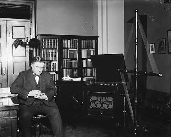Man listening to the radio, 1922. Courtesy of Wikimedia Commons/Library of Congress, Harris & Ewing, photographers.